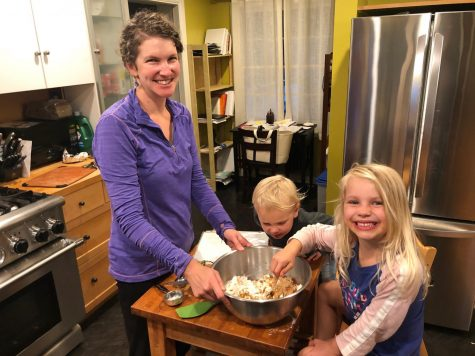 English Teacher Sarah Kreiner making cookies with her family (Photo courtesy of Sarah Kreiner)