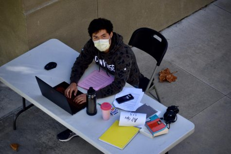 Junior Billy Rosas working at his designated table at school.