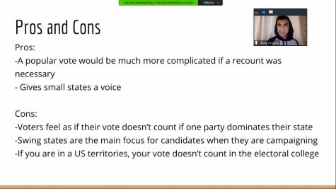 Screenshot of senior Jose Angulo listing pros and cons of the Electoral College system at the school-wide meeting on Zoom on Nov. 6.