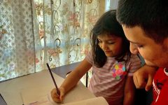 Sophomore Diego Salazar helping out his little sister with homework (Photo courtesy of Alejandra Salazar)