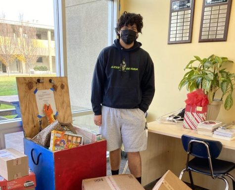 Sophomore Juan Ibarra admires the collected toys in the front office.